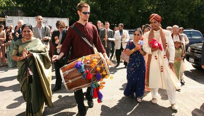 After composing and transcribing music for my wedding day, Red Baraat was born. Dave Sharma leads the baraat (wedding procession) on dhol, as I walk with my mother, family, and friends. August 27, 2005. (Photo courtesy of Sunny Jain)