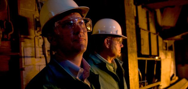 The Castens inside the furnace room at West Virginia Alloy.