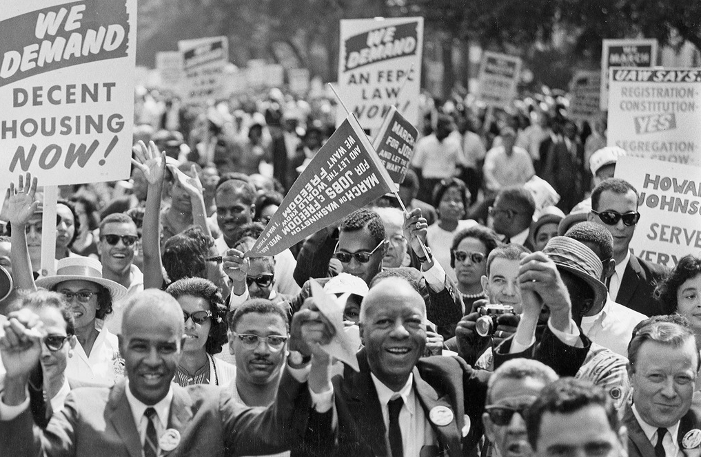 Civil rights leaders stand with protesters at the 1963 March on Washington