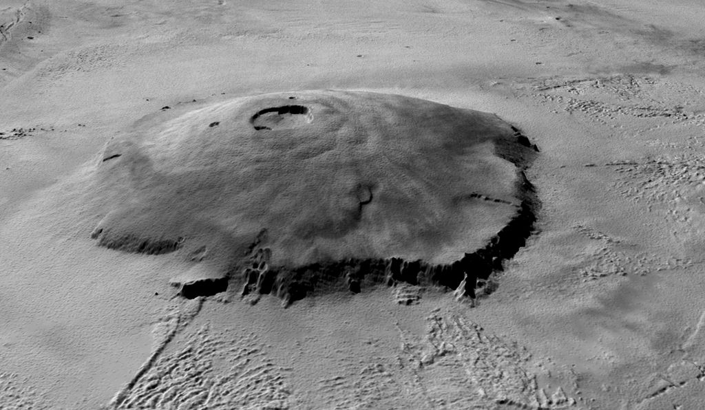 This 3D view of the complete Olympus Mons has been derived from U.S. Mars Orbiter Laser Altimeter (MOLA) topographic data superimposed with the Mars Orbiter Camera (MOC) wide-angle image mosaic.