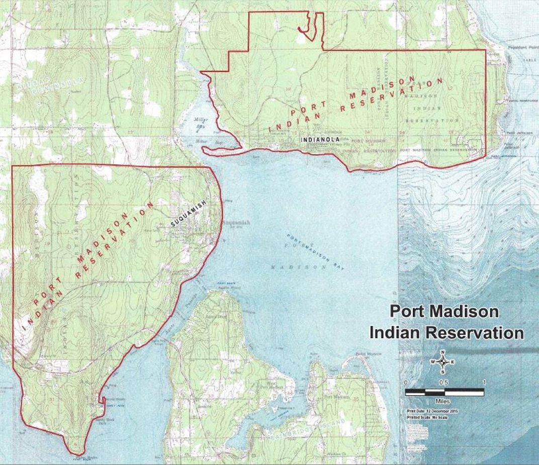 Map showing a portion of the Puget Sound and surrounding land masses. Two areas of land are outlined in red, marked Port Madison Indian Reservation.