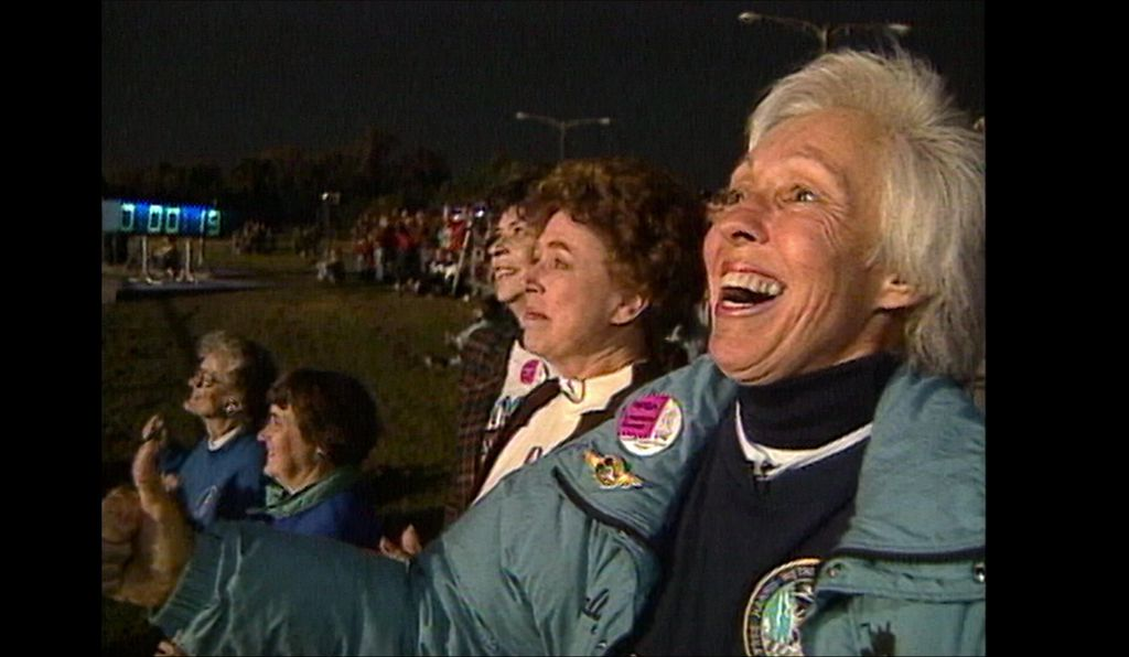 Wally Funk (foreground) and several other Mercury 13 trainees exult at the launch of STS-63 in 1995—the first Space Shuttle mission with a woman pilot, United States Air Force Colonel Eileen Collins.