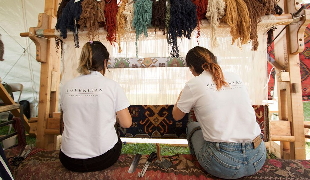 Twin sisters Sahkanush and Haykanush Stepanyan at their loom at the Smithsonian Folklife Festival.