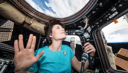 astronaut in space giving Vulcan salute