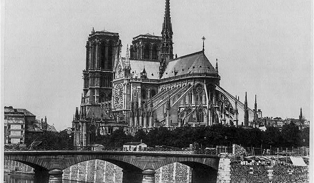 About 20 years after Victor Hugo wrote <em> Notre-Dame de Paris</em>, in 1830, this photograph was taken of the cathedral from across the Seine.