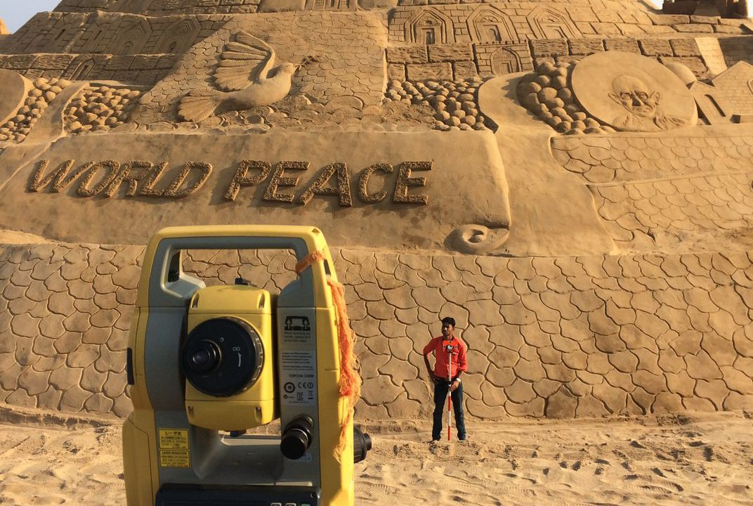 These photos show just how colossal the world's tallest sandcastle is