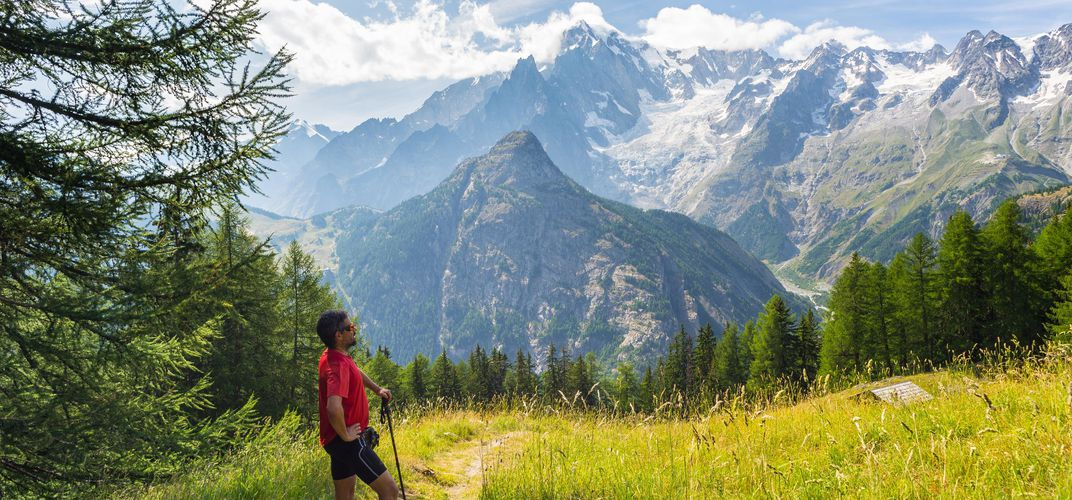 Hiker looking out over Mont Blanc