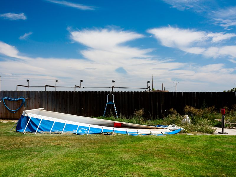 A Collapsed Above-ground Pool, Taken In My Father's