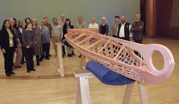 Members of the staff of the National Museum of the American Indian in New York hold a welcoming ceremony for a kayak frame built in the traditional Yup'ik way at the Qayanek Qayak Preservation Center in Kwigillingok, Alaska. A testament to the ingenuity and innovation of the Native cultures of the Arctic, the kayak frame will become a teaching exhibit when the New York museum's imagiNATIONS Activity Center opens this May. (National Museum of the American Indian, Smithsonian)