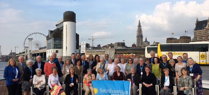 Travelers enjoying a river cruise along the canals and waterways of Holland and Belgium