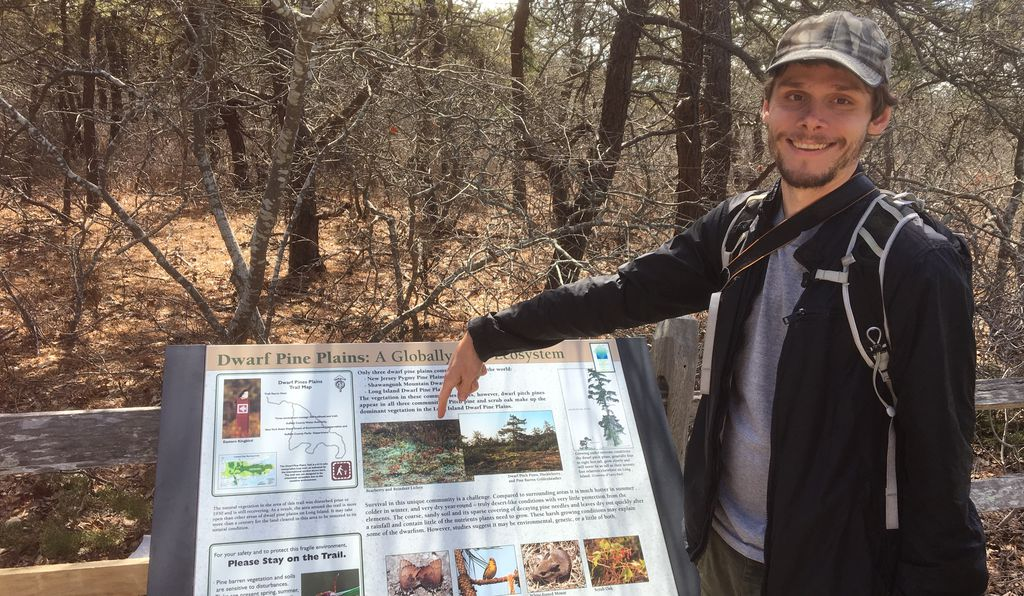 Lendemer points out a photo of <I>C. submitis</i> on a trailside placard.