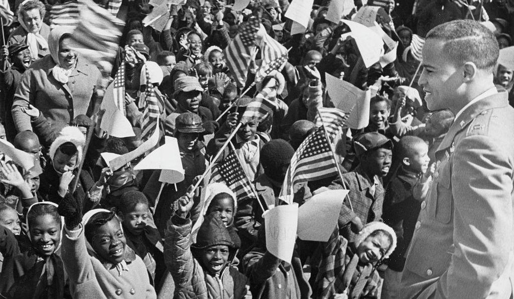Dwight got a hero's welcome from youngsters at Langdon Elementary School, in Washington, D.C., in March 1964.
