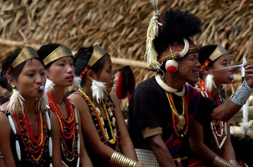 Phom tribe gather during a festival wearing traditional