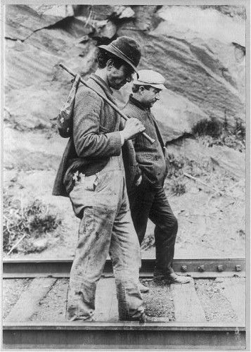 Tramps hoping to hitch a ride on the rails, c. 1907.