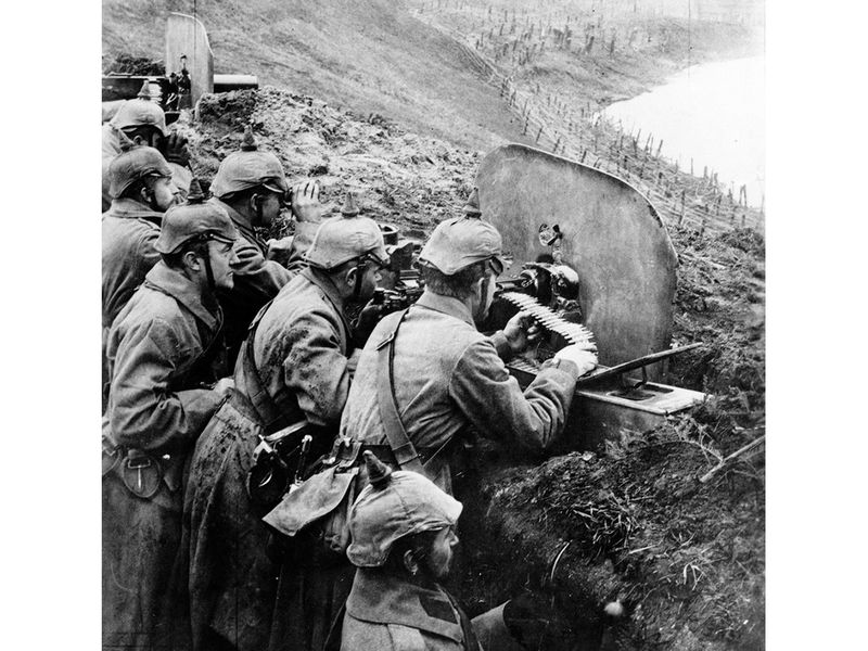 German infantrymen aim machine guns from a trench near the Vistula River in 1916.
