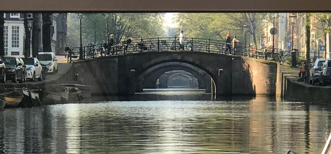 View of the bridges in Amsterdam during a canal tour