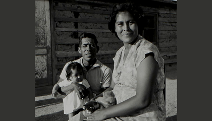 Patricia Stone (Akimel O'otham) and Leonard Stone (Akimel O'otham) with their new baby, 1965. Gila River Indian Community, Arizona. (Helge Teiwes Collection, NMAI.AC.070)