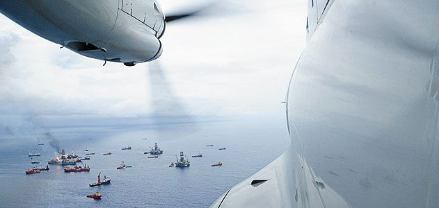 From the cockpit of a Coast Guard HC-144 patrol plane, the armada surrounding the deep water horizon rig last June appears placid.