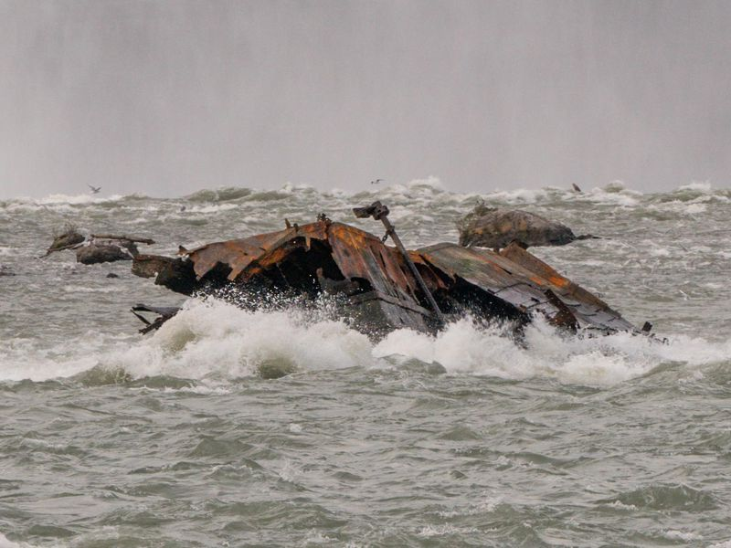 The Iron Scow adrift down in the rapids above Canadian Horseshoe Falls.
