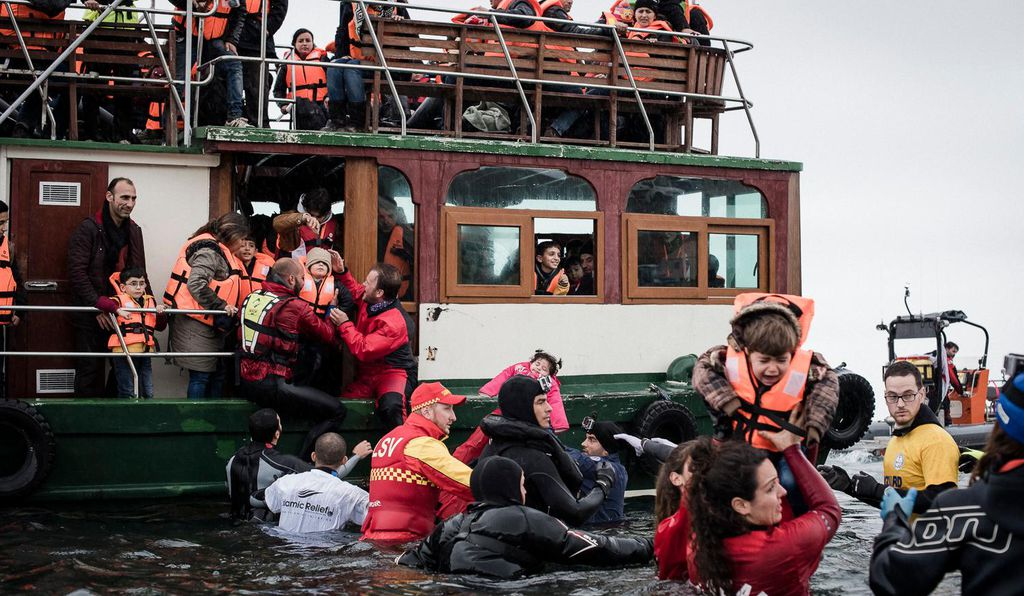 Over 200 Syrian refugees arrive at Limantziki Beach in Lesvos, Greece, in one of the largest boat arrivals to have made the crossing from Turkey.