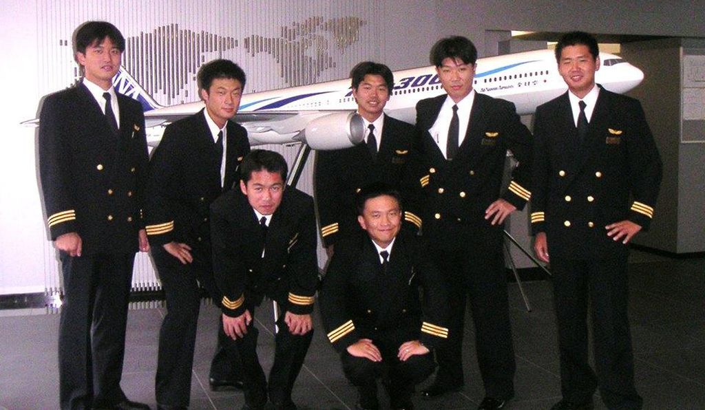 Onishi (far left) back in his airline flying days.