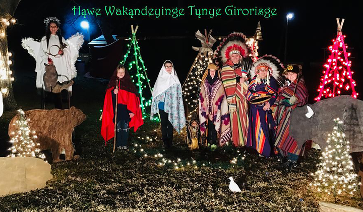 Hąwe Wakąndeyinge Tųnye Girorisge! (Merry Christmas!) This Native nativity scene took place at the Otoe–Missouria Tribal Complex near Red Rock, Oklahoma, as part of their Light up the Encampment Grounds event. The animal figures represent the seven clans of the Otoe-Missouria Tribe. Instead of a manger, a cradleboard holds the newborn Jesus. (Photo use with permission, courtesy of Johnnie Dee Childs)
