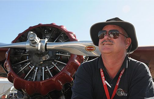 Richard Rezabek's 1937 Stinson SR-9F got the attention of the fans as well as the judges. Besides winning the trophy in the Classic category (aircraft built and flow in 1936 or later), the red-and-black Stinson gull-wing Reliant grabbed the most votes in