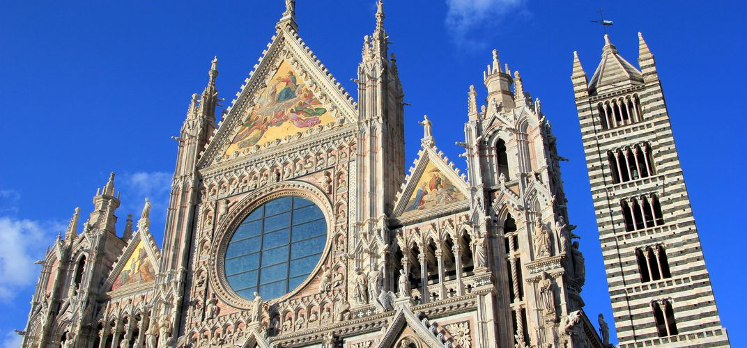 The facade and distinctive belltower of Siena's cathedral