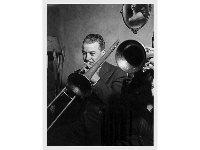 Kid Ory plays the trombone.