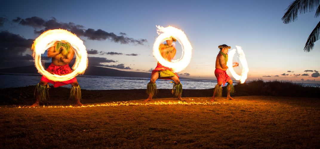 Fire dance performance at a luau