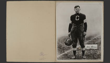 "Jim Thorpe (Sac and Fox), with the inscription ""To my little girl Grace From Dad Jim Thorpe 1951."" The photo, in the original folder frame, shows Thorpe during his career with the Canton Bulldogs football team, ca. 1915 to 1920. Grace Thorpe Collection, NMAI.AC.085 (pht_092_002). (National Museum of the American Indian Archives Center, Smithsonian)"