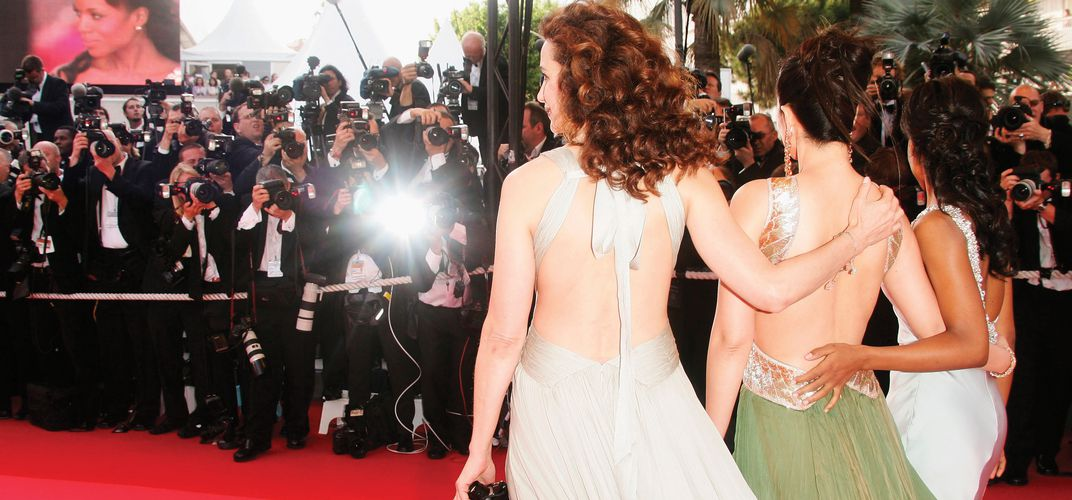 The cameras flash in a frenzy when stars approach the Red Carpet