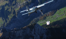 French Daredevils Leap Off a Perfectly Good Mountain into a Moving Airplane