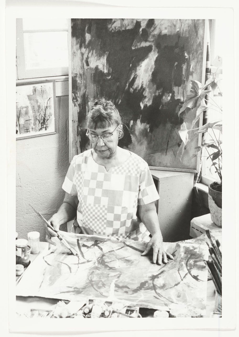 Photograph of Alma Thomas painting in her studio