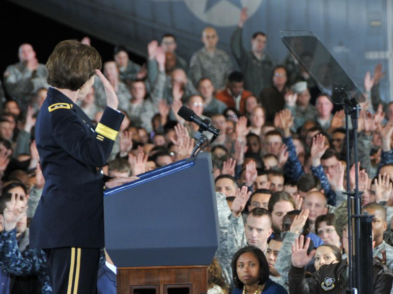 Army Reserve members raise hands