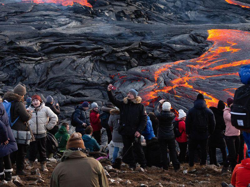 A man take a selfies in front of the lava field on March 28, 2021 on the Reykjanes Peninsula, Iceland