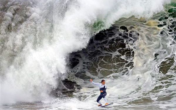 Surfs up! Crowds flock to California beaches