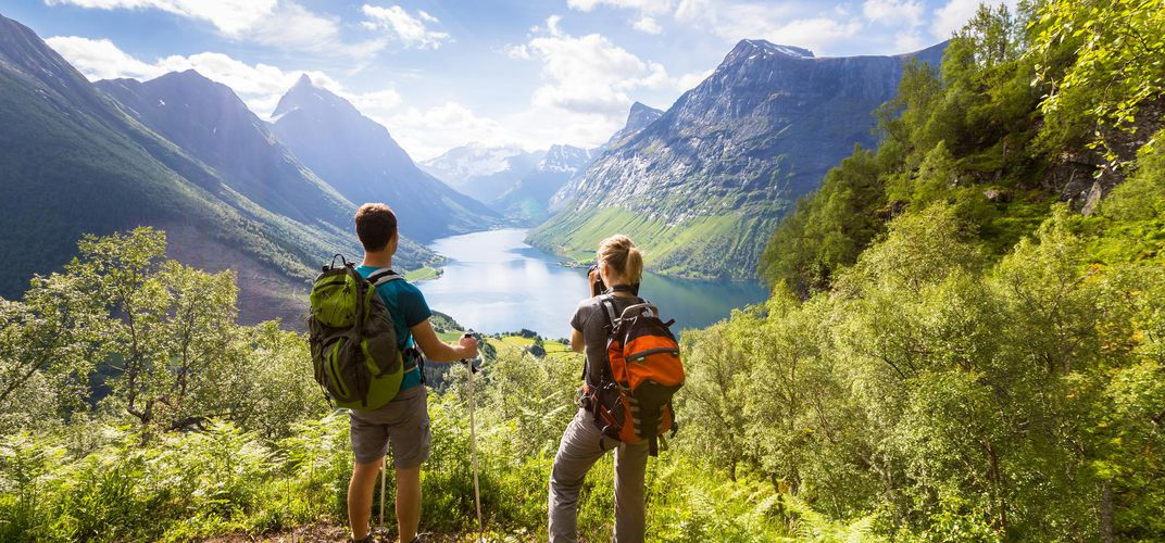 Hikers viewing a fjord