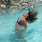 Hair flip in a pool.