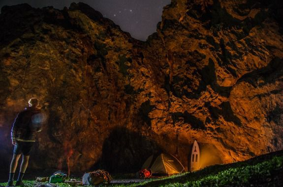 The tent is pitched against a cliff, and the stars of the Baja sky come out.