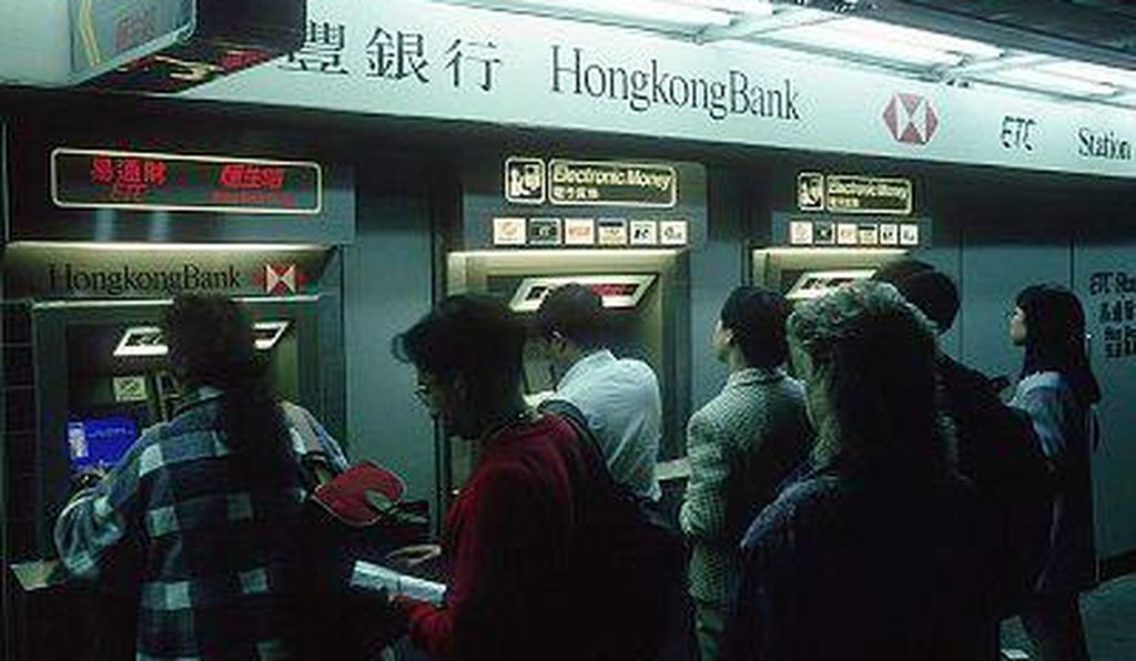 Customers using ATM's at Hong Kong Bank.