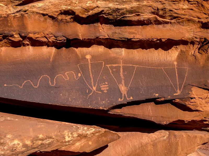 Birthing Rock petroglyphs with triangle anthropomorphs