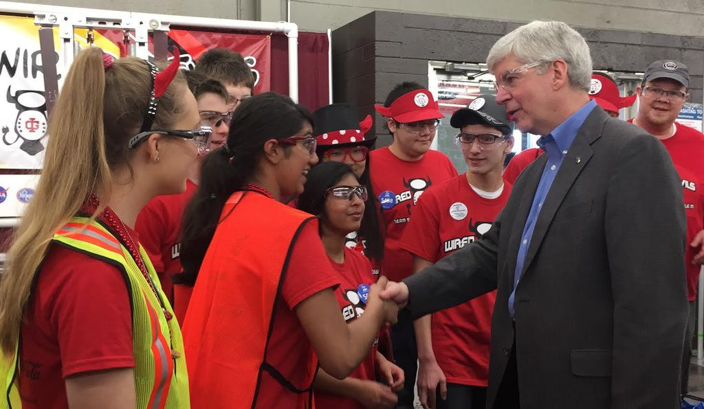 Keena, shown shaking hands with Michigan Gov. Rick Snyder at a 2016 state robotics competition, and her sister Maya, to her right.