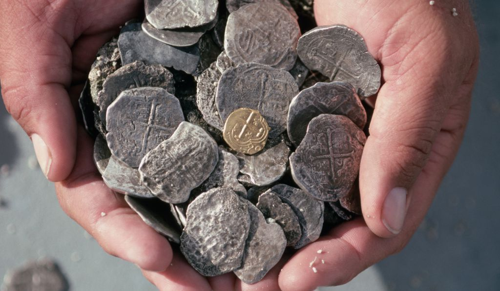 These Spanish silver coins were recovered from a shipwreck in the Bahamas in the 17th century.