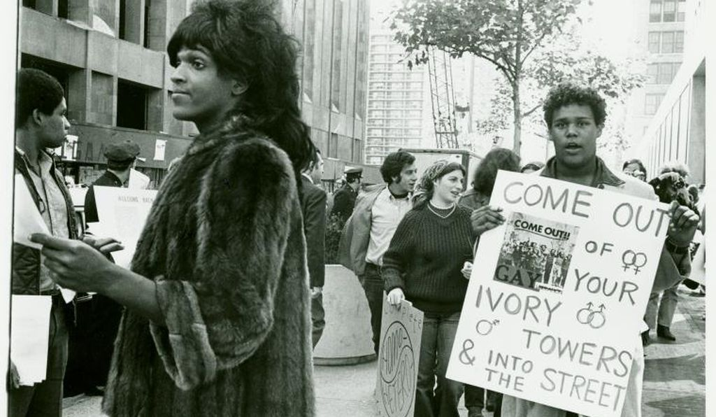 Marsha P. Johnson hands out flyers to students at New York University.