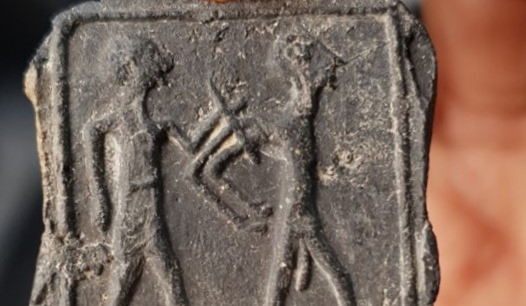 A rare Canaanite tablet depicts a man leading his naked captive