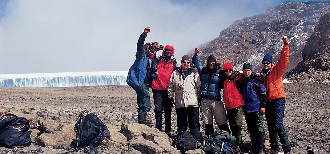 Hikers in front of Arrow Glacier, excited to summit the next day