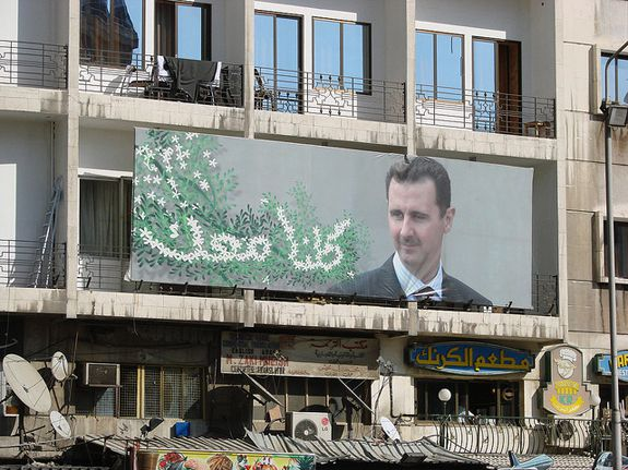 A poster for Syrian President Bashar al-Assad hangs in Damascus.