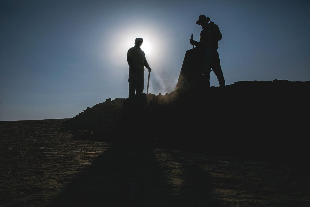two figures            at dig site