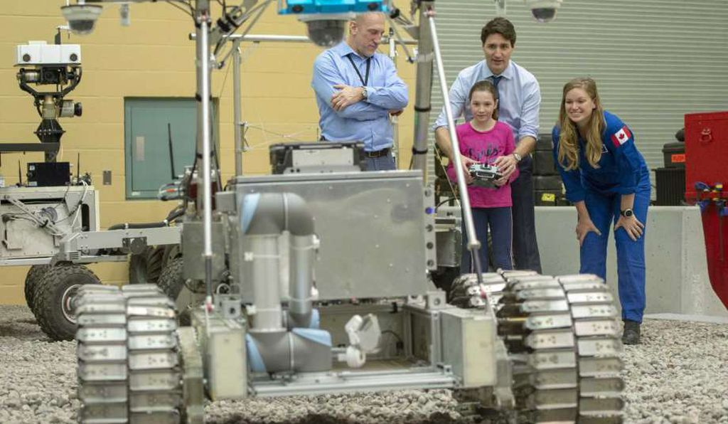 Only three nations have landed on the moon, but others are eager to join that fraternity. Canadian Prime Minister Justin Trudeau and his daughter Ella Grace test-drive a Juno 6 moon rover with astronaut Jennifer Sidey-Gibbons. The vehicle has been tested in Hawaiian volcanoes as it awaits lunar deployment.